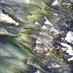 Dark, seasonal flows emanate from bedrock exposures at Palikir Crater on Mars in this image from the High Resolution Imaging Science Experiment (HiRISE) camera on NASA's Mars Reconnaissance Orbiter. Image Credit: NASA/JPL-Caltech/Univ. of Arizona